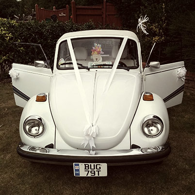 Betty Boo, a triple white/blue stripe Karmann Beetle Cabriolet