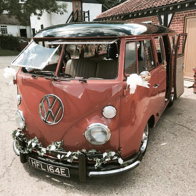 Gino, a coral red Splite Screen Campervan